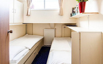 Lower Deck Twin Cabin with half height window. 2 twin beds, 1 folds up into the wall - Bordeaux | Bike & Boat Tours