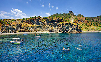 Swimming, biking and boating on the Aeolian Islands in Sicily, Italy.