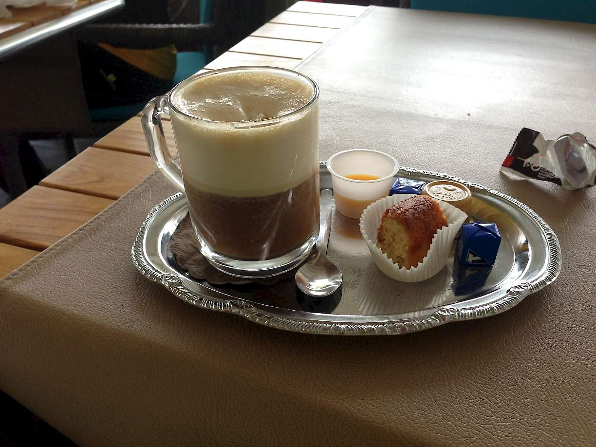 Classic European breakfast, Cappuccino and a sweet.