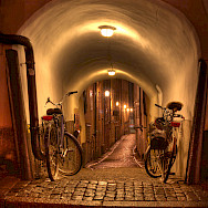 Bicycles resting in Old Town, Stockholm, Sweden. Photo via Flickr:Michael Caven