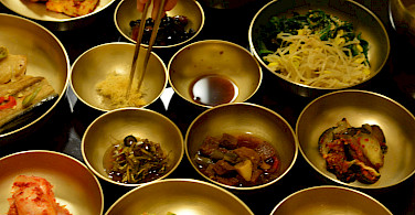 Dining Korean-style with lots of Banchan at Andong Hahoe Folk Village, South Korea. Photo via Flickr:nagranee