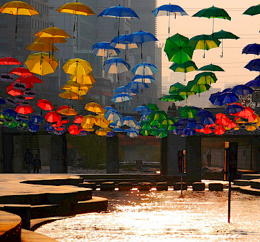 Cheonggyecheon Umbrellas over the Cheonggye Stream in Seoul, South Korea. Photo via Flickr:travel oriented