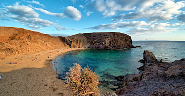 Sunbathing at Papagayo Beach, Lanzarote, Canary Islands. Photo via Wikimedia Commons:Luk Viatour