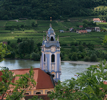 Blue tower of the Stiftskirche greets everyone in the Wachau Valley, Austria. Photo via Flickr:jay8085