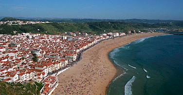 Beautiful beach in Nazare, Portugal. Photo via Flickr:Roberto Ferrari