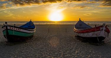 Sunset in Nazare, Portugal. Photo via Flickr:Guillen Perez
