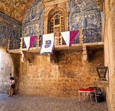 Tiled walls in Obidos, Portugal. Photo via Flickr:Luca Boldrini