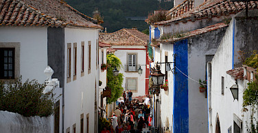 Shopping in Obidos, Portugal. Photo via Flickr:Jean-Michel Brunet
