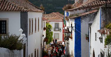 Shopping in Obidos, Portugal. Photo via Flickr:Jean-Michel Brunet