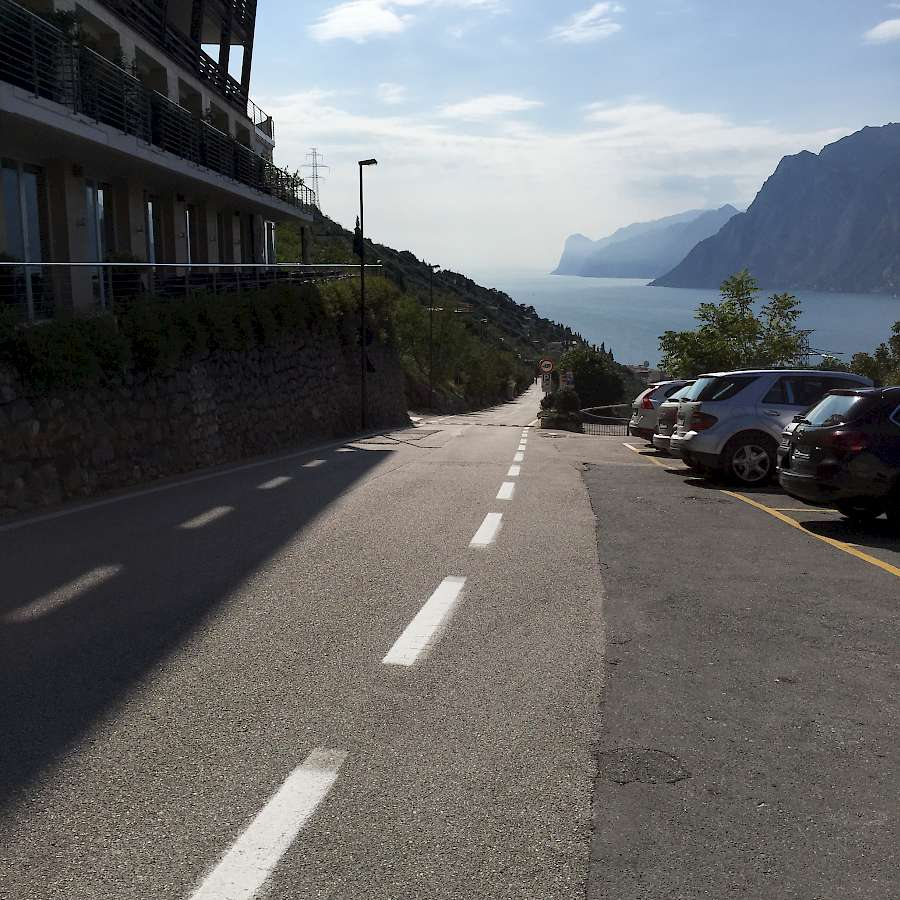 Epic downhill with Lake Garda in the distance
