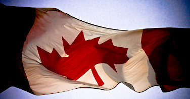 Flag of Canada. Photo via Flickr:Alex Indigo