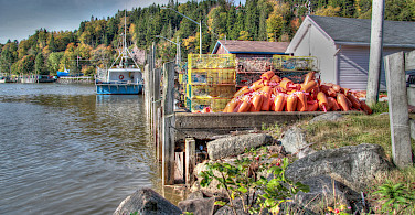 Lobster traps ready in Bay of Fundy, Nova Scotia, Canada. Photo via Flickr:maureen