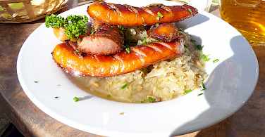 Sausages and sauerkraut in Poland. Photo via Flickr:Dave Collier