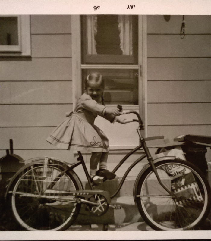 Old picture of girl on bike.