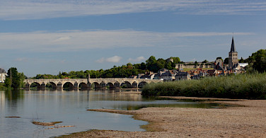 Biking into La Charité sur Loire, France. Photo via Flickr:akial