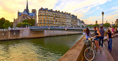 Notre Dame Cathedral in Paris along the Seine River. Photo via Flickr:Moyan Brenn