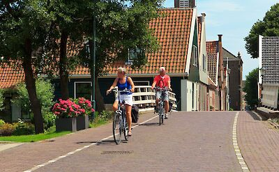 Biking the scenic towns of Holland. ©TO