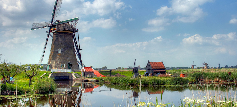 Windmills in Kinderdijk, South Holland, the Netherlands. Photo via Flickr:John Morgan