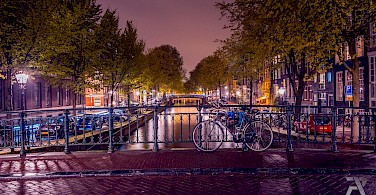 Amsterdam glows at night. Photo via Flickr:Syuqor Aizzat