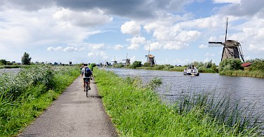 Biking and boating in Kinderdijk, Molenwaard, South Holland, the Netherlands. Photo via Flickr:Luca Casartelli