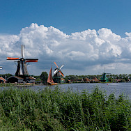 Bike path along the windmills in Zaandam, North Holland, the Netherlands. Photo via Flickr:kismihok