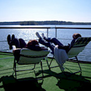 Relax on deck after a day of scenic cycling