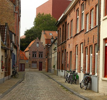 Cobblestone streets await in Bruges, Belgium. Photo via Flickr:Elroy Serrao