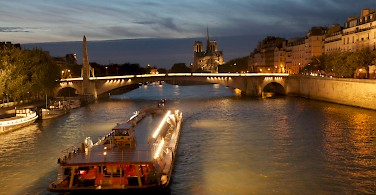 Seine River and the Notre Dame Cathedral, Paris, France. Photo via Flickr:Marko Kudjerski