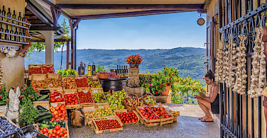 Wine, fruits, view in Motovun on the Istria Peninsula, Croatia. Photo via Flickr:Arnie Papp