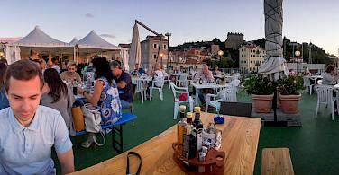 Dining seaside in Muggia, province Trieste, region Friuli-Venezia Giulia, Italy. Photo via Flickr:Oleg Brovko