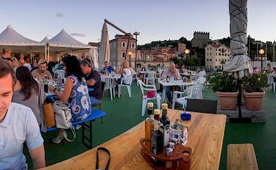 Dining seaside in Muggia, province Trieste, region Friuli-Venezia Giulia, Italy. Flickr:Oleg Brovko