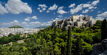 View of the Acropolis from Areopagus, Athens, Greece. Photo via Flickr:Tobias Van Der Elst