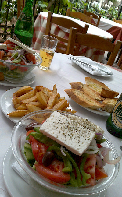 Greek salads and beer for lunch in Athens, Greece. Flickr:Mark Hillary
