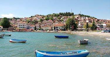 Ohrid lies on Lake Ohrid in Macedonia. Flickr:Xiquinho Silva