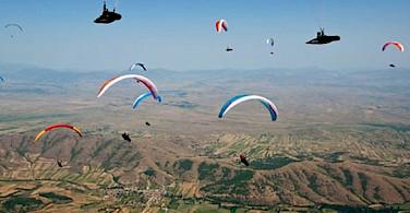 Paragliders soaring in Macedonia.