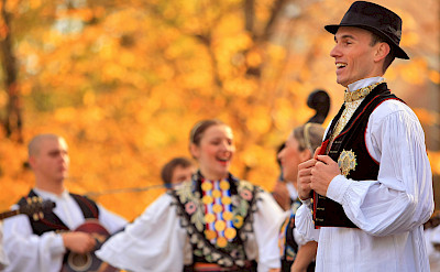 Folk dancing along the Danube River bike tour. ©TO