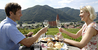 Wine tasting in Weißenkirchen in der Wachau along the Danube River bike tour. Photo courtesy of Radundreisen-Eurocycle