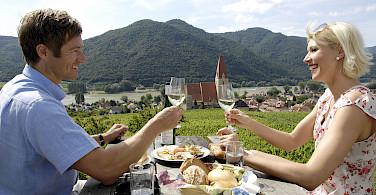 Wine tasting in Weißenkirchen in der Wachau along the Danube River bike tour. Photo courtesy of Radundreisen-Eurocycle