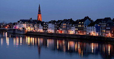 Maastricht along the Maas River, Limburg, the Netherlands. Photo via Flickr:Jorge Franganillo