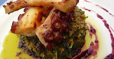 Charred octopus, cornbread and turnip greens in Porto, Portugal. Photo via Flickr:Jessica Spengler