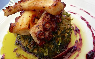 Charred octopus, cornbread and turnip greens in Porto, Portugal. Flickr:Jessica Spengler