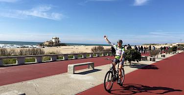 Hennie biking the Promenade in Porto, Portugal.