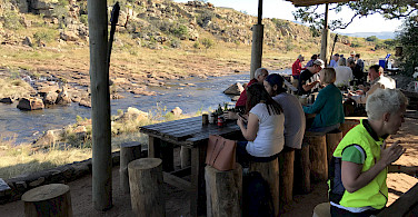 Enjoying a riverside lunch during this great South African bike tour!