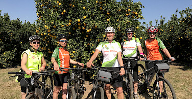 Hennie and crew biking through the orchards in gorgeous South Africa!