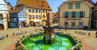 Fountain in Eguisheim, Alsace, France. Photo via Flickr:Kiefer