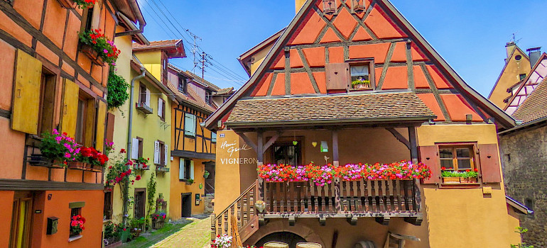 Colorful architecture in Eguisheim, Alsace, France. Photo via Flickr:Kiefer