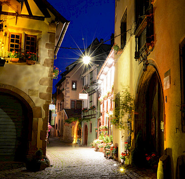 Evening stroll in Riquewihr, Alsace. France. Photo via Flickr:Pug Girl