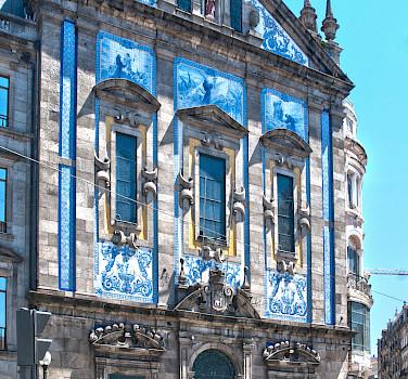 Gorgeous tiled buildings in Porto, Portugal. Photo via Flickr:Berit Watkin