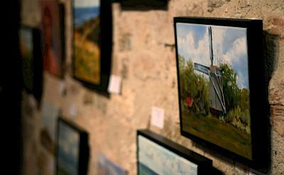 Art gallery bike rest stop in Cordes-sur-Ciel, department Tarn, France. Photo via Flickr:Lloyd Morgan