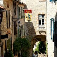 Shopping in Cordes-sur-Ciel, department Tarn, France. Photo via Flickr:Stephane Goldstein